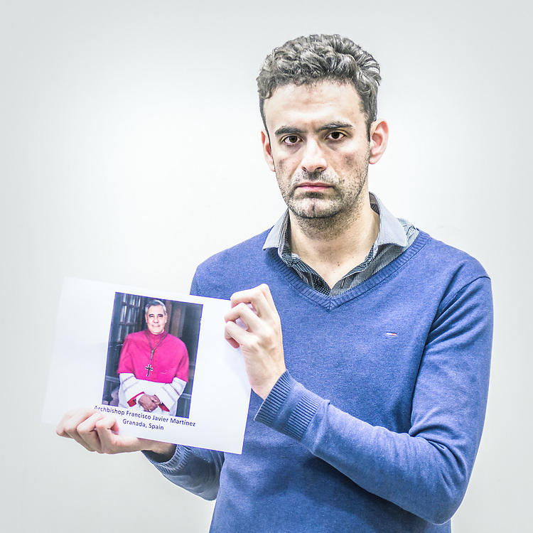 2018<br /> Miguel Hurtado, a survivor and a human rights activist from Spain, poses for a portrait showing a picture of the Archbishop Francisco Javier Martinez Fernandez who in seven occasions refused to turn to court the documents about his archdiocese's handling of 10 accused priests in Granada. © Simone Padovani
