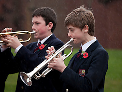 © under licence to London News Pictures 11/11/2010 Solihull School, West Midlands, came to a standstill at 11am this morning to take part in the school Armistice service. Pupils sound this last post as rain pours down during the service...