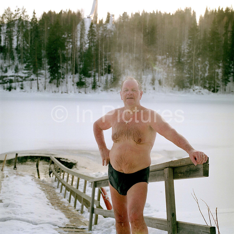 A portrait of a man after ice swimming at the small lake Vuorilampi, Jyvaskyla, Central Finland. Ice swimming takes place in a body of water with a frozen crust of ice, which requires a hole cutting in it.  In Finland, the ice swimming tradition has generally been connected with the sauna tradition and it is not seen as an ascetic or religious ritual, but as a way to cool off rapidly after staying in the sauna and as a stress relief.