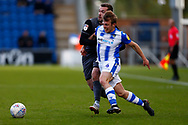 Colchester United midfielder Tom Lapslie (4) Lincoln City defender Harry Toffolo (14) battles for possession during the EFL Sky Bet League 2 match between Colchester United and Lincoln City at the JobServe Community Stadium, Colchester, England on 27 October 2018.