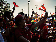 10 MAY 2014 - BANGKOK, THAILAND: Red Shirt supporters wave their noise makers in the air at a Red Shirt rally in Bangkok. Thousands of Thai Red Shirts, members of the United Front for Democracy Against Dictatorship (UDD), members of the ruling Pheu Thai party and supporters of the government of ousted Prime Minister Yingluck Shinawatra are rallying on Aksa Road in the Bangkok suburbs. The government was ousted by a court ruling earlier in the week that deposed Yingluck because the judges said she acted unconstitutionally in a personnel matter early in her administration. Thailand now has no functioning government. Red Shirt leaders said at the rally Saturday that any attempt to impose an unelected government on Thailand could spark a civil war. This is the third consecutive popularly elected UDD supported government ousted by the courts in less than 10 years.    PHOTO BY JACK KURTZ