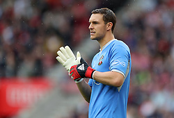 """Southampton goalkeeper Alex McCarthy during the Premier League match at St Mary's, Southampton. PRESS ASSOCIATION Photo. Picture date: Sunday August 12, 2018. See PA story SOCCER Southampton. Photo credit should read: Andrew Matthews/PA Wire. RESTRICTIONS: EDITORIAL USE ONLY No use with unauthorised audio, video, data, fixture lists, club/league logos or """"live"""" services. Online in-match use limited to 120 images, no video emulation. No use in betting, games or single club/league/player publications."""