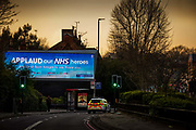 Huge billboard on the Archway road publicly thanking NHS workers for their front line contribution during the Coronavirus pandemic on 26th March 2020 in London, United Kingdom. That evening all around the UK people took part in a Clap for Carers tribute, applauding as a nation from their homes.