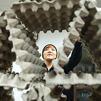 Gabrielle Thomas, 20, uses egg cartons to create tower during the Weimagination class at the UNM-Gallup campus on Nov. 30th.
