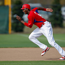 February 22, 2011; Clearwater, FL, USA; Philadelphia Phillies right fielder Domonic Brown (9) runs in a base running drill during spring training at Bright House Networks Field. Mandatory Credit: Derick E. Hingle-US PRESSWIRE