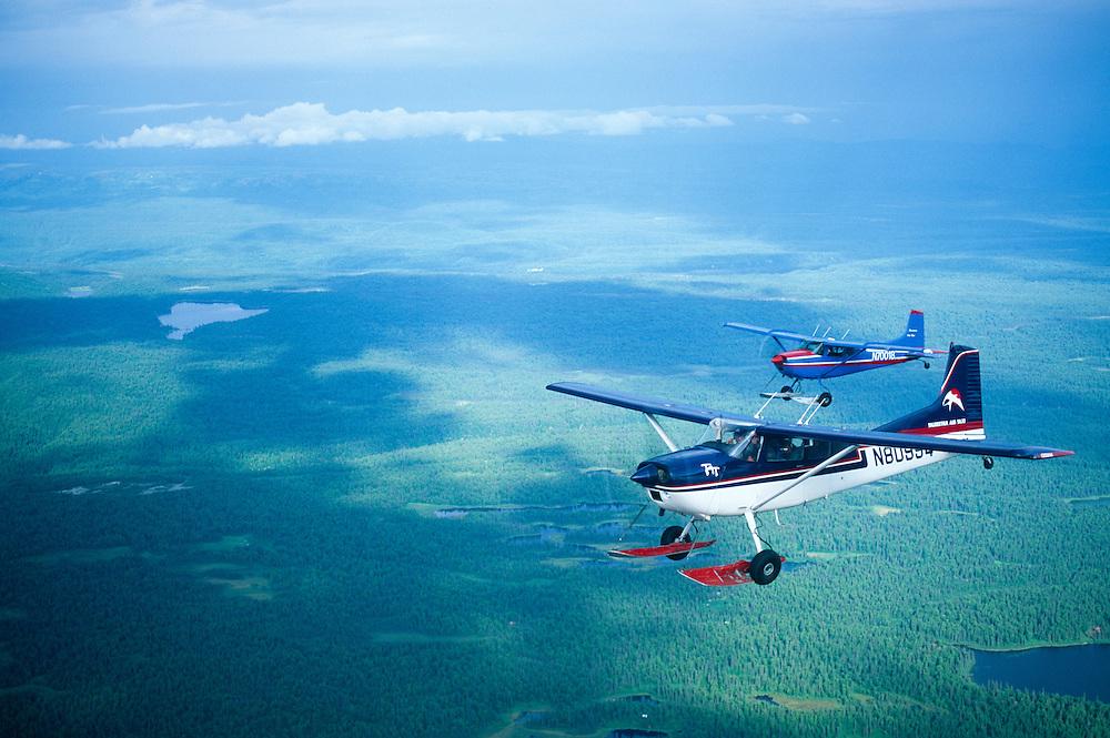 Alaska, Denali State Park. Bush planes above Tokositna Valley in route to Mt. McKinley flightseeing.