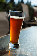 USA, Oregon, Keizer, a glass of IPA on the deck.