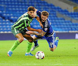 Will Nightingale of AFC Wimbledon tussles with Aron Gunnarsson of Cardiff City - Mandatory by-line: Paul Knight/JMP - Mobile: 07966 386802 - 11/08/2015 -  FOOTBALL - Cardiff City Stadium - Cardiff, Wales -  Cardiff City v AFC Wimbledon - Capital One Cup