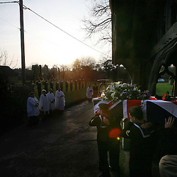 Mcc0010752.DT>The funeral of William Stone one of 3 survivors of The Great War WW1at St Leonards Church in the village of Watlington in Oxfordshire.29/1/. William Stone's body is carried from the church
