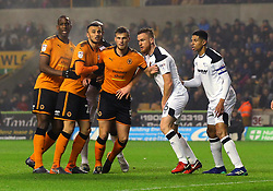 Ryan Bennett, Romain Saiss of Wolverhampton Wanderers and Willy Boly of Wolverhampton Wanderers take on Alex Pearce and Curtis Davies of Derby County - Mandatory by-line: Robbie Stephenson/JMP - 11/04/2018 - FOOTBALL - Molineux - Wolverhampton, England - Wolverhampton Wanderers v Derby County - Sky Bet Championship