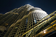 Low angle photo of the famous Burj Khalifa building at night. It is the tallest building in the world, as of 2021, located in Dubai, United Arab Emirates