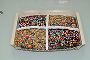Home made Chocolate birthday cake decorated with marshmallows and hundreds and thousands sweets