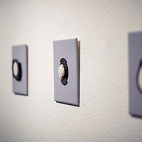 """031314       Cable Hoover<br /> <br /> Kristi Wilson's cloth and metal broaches are displayed in her show """"Rethinking Sentimentality"""" at UNM-Gallup Friday."""