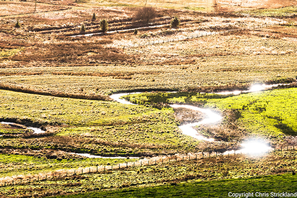 Hownam, Kelso, Scottish Borders, UK. 29th December 2018. Sunshine bounces off the Kale Water near Hownam village in the foothills of the Cheviots near the Anglo Scottish Border.