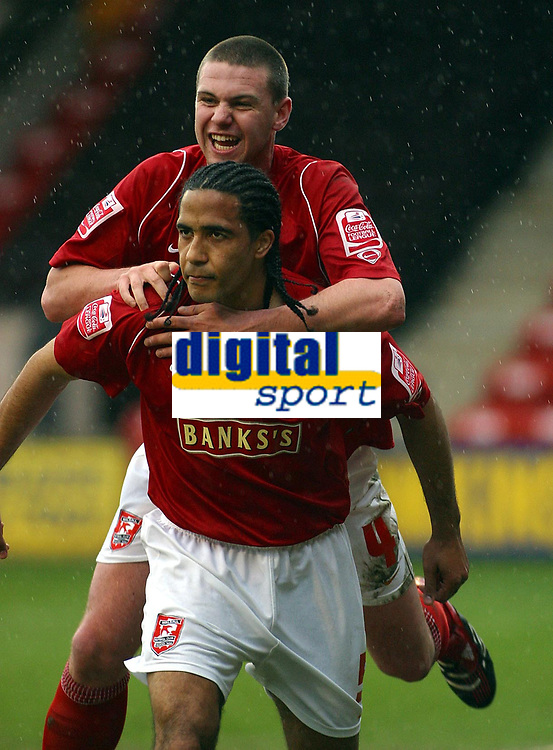 Photo: Dave Linney.<br />Walsall v Bradford City. Coca Cola League 1. 25/03/2006<br />Walsall goalscorer Chris Westwood(front ) makes it 2-0 and is congratulated by   Anthony Gerrard.