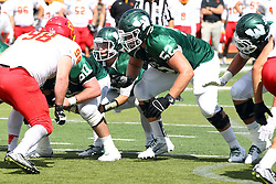 19 September 2015:  Jack Warner takes a rare snap from under center in order to ground the ball to stop the clock.  He is protected by Frank Toland (52) during an NCAA division 3 football game between the Simpson College Storm and the Illinois Wesleyan Titans in Tucci Stadium on Wilder Field, Bloomington IL