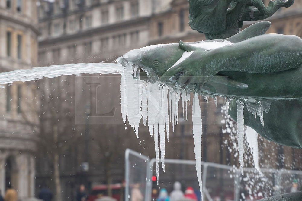 © Licensed to London News Pictures. 01/03/2018. London, UK. Icicles form on Trafalgar Square's iconic fountains as more snow fell overnight and temperatures stay below zero. The 'Beast from the East' and Storm Emma have brought extreme cold and heavy snow to the UK. Photo credit: Peter Macdiarmid/LNP