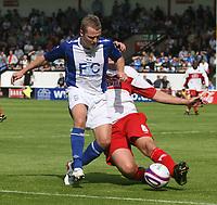 Photo: Mark Stephenson.<br /> Walsall v Birmingham City. Pre Season Friendly. 28/07/2007.Birmingham's Garry McSeffery is tackeled by Walsall's Danny Sonner