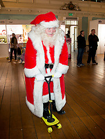 father christmas riding a morf board at  DreamToys 2018! the Toy Retailer's Associationreveal the DreamToys list at St Mary's Church, Wyndham Place, York Street, W1H 1PQ.