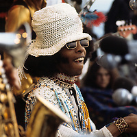 Sly and the Family Stone .- .Playing at the Isle of Wight was no mean feat for Sly as he had missed almost a third of his public appearances that year.  He was allegedly heavily into drugs, and reportedly becoming suspicious of his band members.  In 1972 the conflict became so bad that Larry Graham, his bass guitarist since 1966, quit and moved onto other projects, requiring the temporary recruitment of Bobby Womack to cover his absence