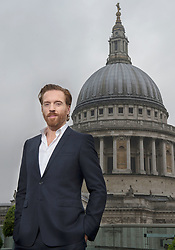 Embargoed to 1200 Wednesday May 11 Damian Lewis poses beside St Paul's Cathedral before opening the London Stock Exchange ahead of the May 12 premiere of Sky AtlanticÕs Billions on Sky Box Sets, which stars Lewis as a hedgefund manager.