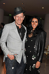PAUL SIMONON and SERENA REES at an after party following the first night of Dr Dee: An English Opera,  an opera created by theatre director Rufus Norris and musician and composer Damon Albarn held at St.Martin's Lane Hotel, St.Martin's Lane, London on 25th June 2012.