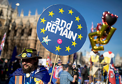 © Licensed to London News Pictures. 14/02/2019. London, UK. An anti-Brexit demonstrator holds a placard outside the Palace of Westminster. MPs continue to debate Brexit in Parliament, and will vote on a series of amendments today. Photo credit: Rob Pinney/LNP