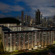 A social housing estate in Hong Kong. In the backdrop are skyscrapers.