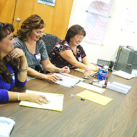 110612  Adron Gardner<br /> <br /> Cibola county poll workers Josalynn Griego, left, Lori Martinez and Julie Sandoval await voters on election day at the county clerk's office in Grants