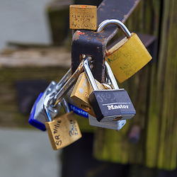 Harpers Ferry, WV / USA - November 3, 2018: Locks that sweethearts had locked to a bridge to symbolize their unbreakable love.