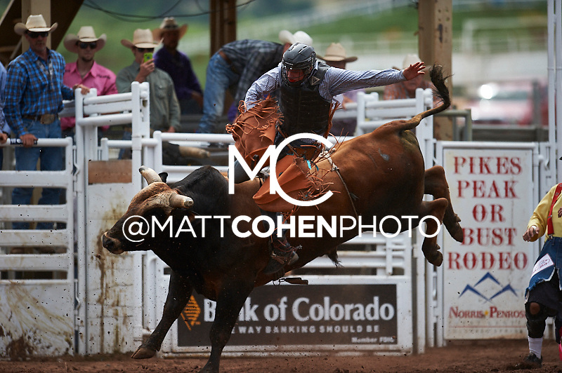 Bull rider Chris Roundy of Spanish Fork, UT gets bucked off Give Her A Whirl at the Pikes Peak or Bust Rodeo in Colorado Springs, CO.<br /> <br /> <br /> UNEDITED LOW-RES PREVIEW<br /> <br /> <br /> File shown may be an unedited low resolution version used as a proof only. All prints are 100% guaranteed for quality. Sizes 8x10+ come with a version for personal social media. I am currently not selling downloads for commercial/brand use.
