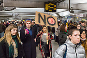 Demonstrators pass through Westminster station to gather outside Downing Street on Monday the 30th of January to protest against the recent announcement by American President Donald Trump to ban people from seven Muslim-majority countries from entering the US. Downing Street, London. 30th January 2017