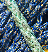 Colorful fishing ropes form diagonal patterns as they are stored for fishing season