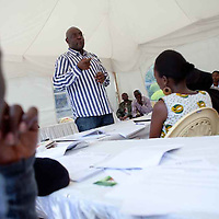 """Mr. Isacc Awuondo, Managing Director & Chief Executive Officer at Commercial Bank of Africa Limited, discusses effective financial management at the  Fall 2011 Network of Young Women Leaders (NoYWL) """"Answer the Call to Lead"""" training."""