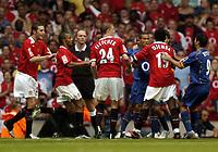 Photo: Richard Lane.Digitalsport<br /> Arsenal v Manchester United. FA Community Shield. 08/08/2004.<br /> Eric Djemba Djemba and Gael Clichy scrap.