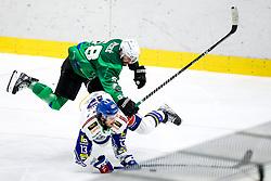 Sebastien Piche of HK SZ Olimpija vs Chris Collins of EC Grand Immo VSV during ice hockey match between HK SZ Olimpija Ljubljana and EC GRAND Immo VSV in bet-at-home ICE Hockey League, on October 22, 2021 in Hala Tivoli, Ljubljana, Slovenia. Photo by Morgen Kristan / Sportida