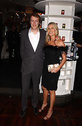 TOM PARKER BOWLES son of Camilla Parker Bowles and MISS SARA BUYS at a party to celebrate the publication of 'E is for Eating' by Tom Parker Bowles held at Kensington Place, 201 Kensington Church Street, London W8 on 3rd November 2004.<br />