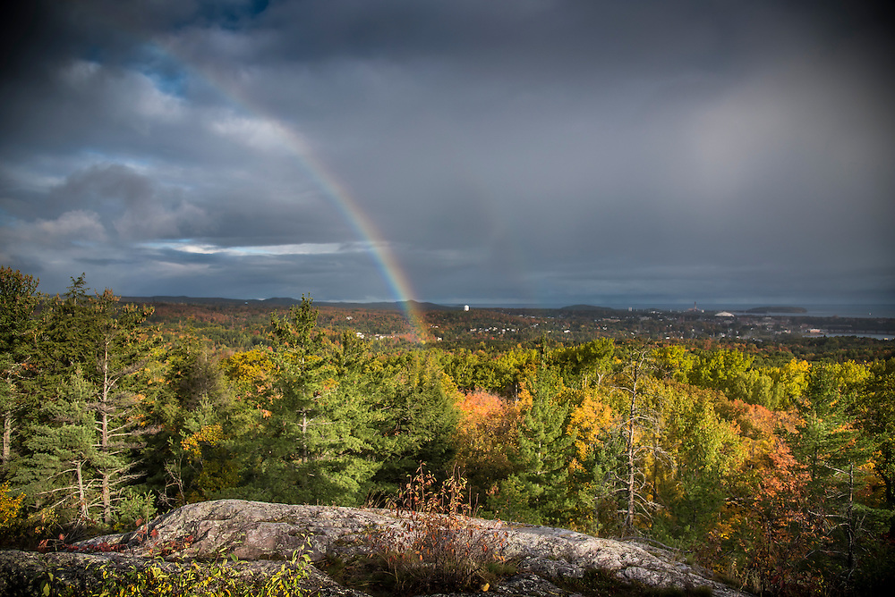 Fall color and a rainbow from the Mount Marquette overlook in Marquette, Michigan.