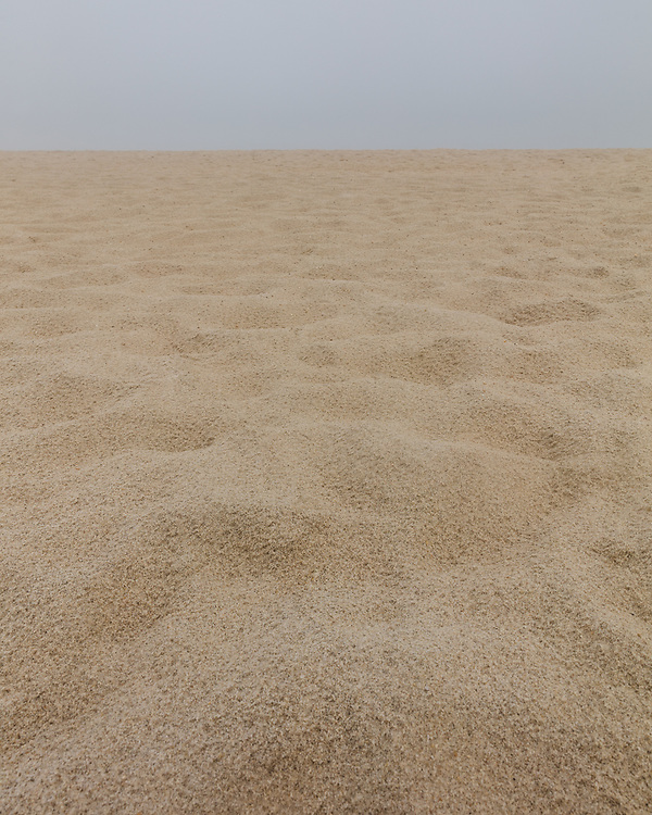The countless grains of sand making up the beach landscape at Surfside.