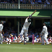 Michael Hussey keeps the ball off his stumps during the Australia V Pakistan 2nd Cricket Test match at the Sydney Cricket Ground, Sydney, Australia, 6 January 2010. Photo Tim Clayton