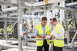 Two engineers in meeting at geothermal power station, Bavaria, Germany