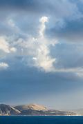 Unusual cloud formations above Dorset's Jurassic coastline, England, UK.