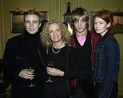 Left to right, MR ACE MILLS (real name Jason Lawson), his mother actress HAYLEY MILLS, MR CRISPIAN MILLS and his wife JOSEPHINE MILLS, at a party in London on 24th February 2000.OBO 59