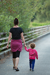North America, United States, Washington, Kirkland, mother and daugther walking in Juanita Bay Park.