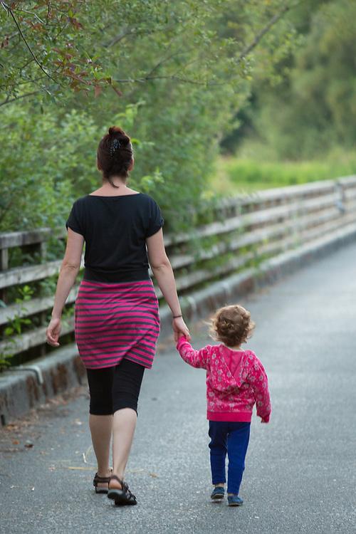 North America, United States, Washington, Kirkland, mother and daugther walking in Juanita Bay Park.