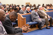 A worshipper prays as North Charleston Mayor Keith Summey joins a healing service at Charity Missionary Baptist Church April 12, 2015 in North Charleston, South Carolina. Sharpton spoke following the recent fatal shooting of unarmed motorist Walter Scott police and thanked the Mayor and Police Chief for doing the right thing in charging the officer with murder.