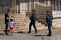 Paris , France - April 26 , 2020 :  Policemen crontroling in Montmartre during the  lock down coronavirus covid-19 quarantine