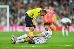 May 2, 2018 - Madrid, Spain - MADRID, SPAIN. May 1, 2018 - Marco Asensio lies injuried on the floor. With a 2-2 draw against Bayern Munchen, Real Madrid made it to the UEFA Champions League Final for third time in a row. Kimmich and James scored for the german squad while Karim Benzema did it twice for los blancos. Goalkeeper Keylor Navas had a great night with several decisive interventions. (Credit Image: © VW Pics via ZUMA Wire)