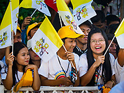 30 NOVEMBER 2017 - YANGON, MYANMAR: Women wave Vatican flags before the Papal Mass at St. Mary's Cathedral in Yangon. Thursday's mass was his last public appearance in Myanmar. From Myanmar the Pope went on to neighboring Bangladesh.    PHOTO BY JACK KURTZ