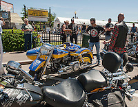 Doug Asermely registers motorcycles participating in the NH Humane Society ride starting from Rally Headquarters on Lakeside Avenue Monday morning.  (Karen Bobotas/for the Laconia Daily Sun)